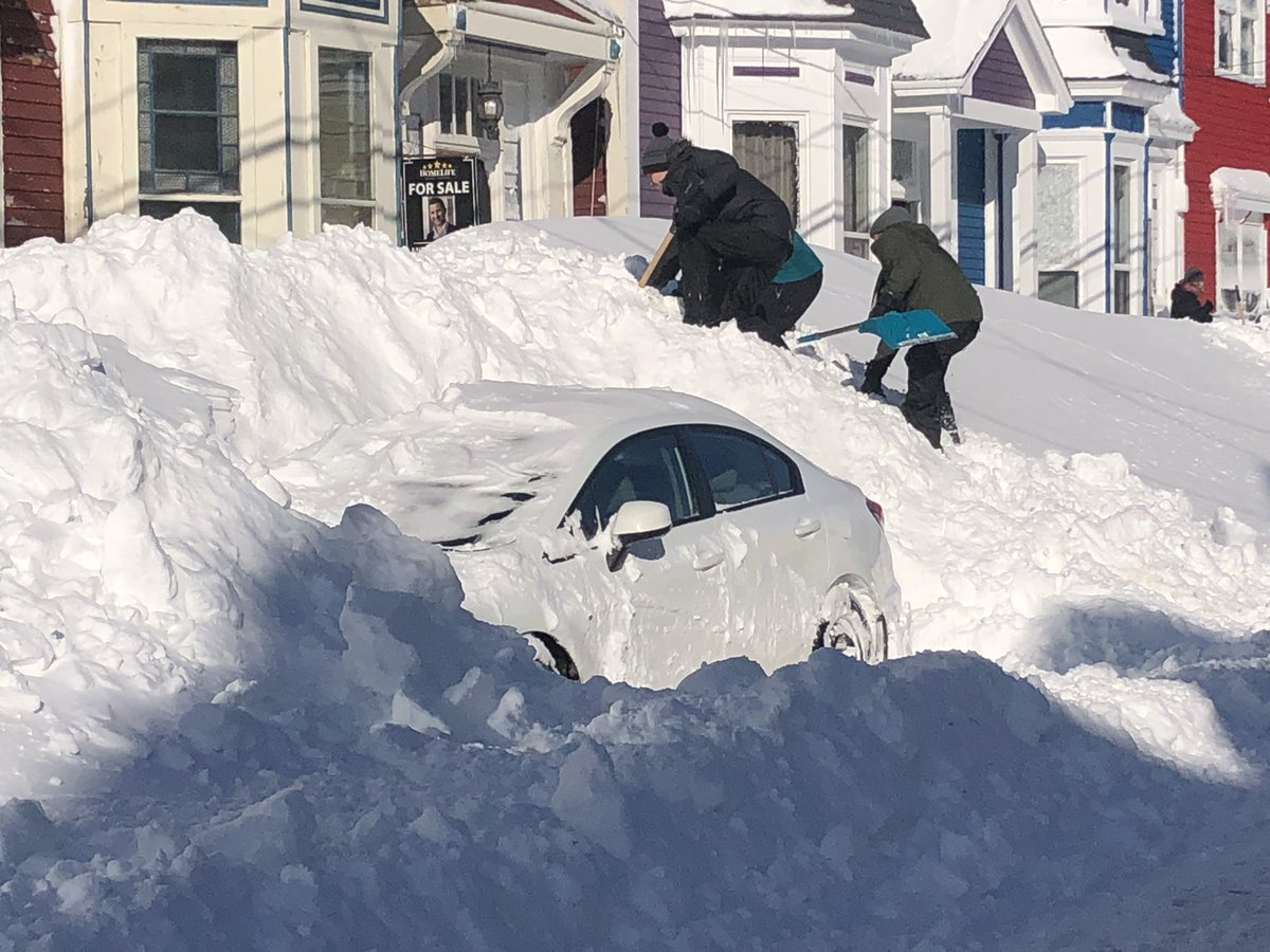 These fine souls, trying to dig out a fire hydrant. #nlblizzard2020 #NLStorm2020