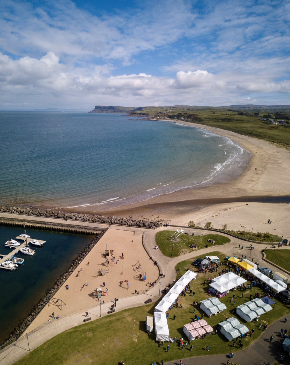 We are lucky to have such beautiful views and spaces to explore along the Causeway Coast.  Photo of the market at Ballycastle seafront overlooked by Fairhead.  Photo by Conor Edgell #visitcausewaypic.twitter.com/rb0UFFpYL9