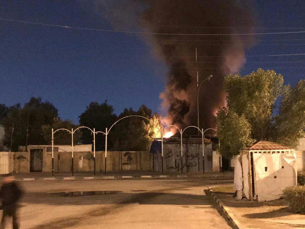 IRAQ: Kata'ib Hezbollah headquarters in the city of Najaf was burned down by protesters tonight. <br>http://pic.twitter.com/RcLNN8PqLf