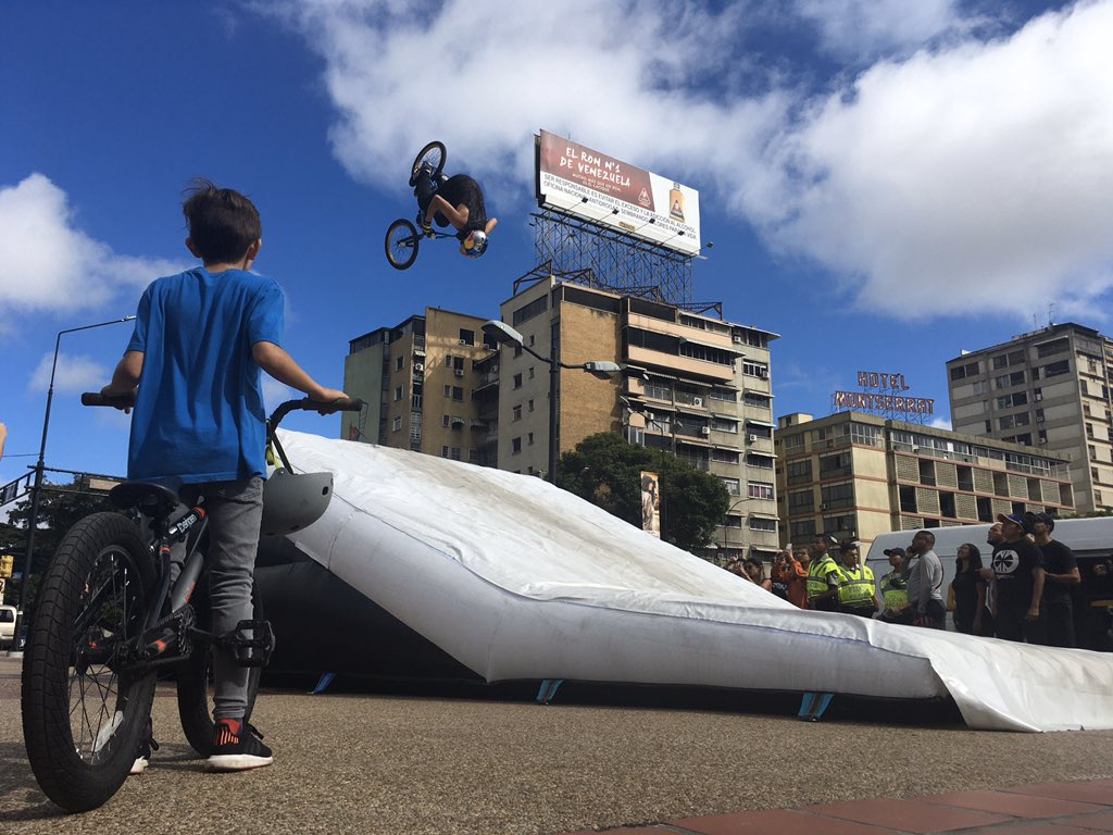 A kid observes @Danieldhers, a Venezuela pro BMX rider, during a exhibition in Caracas, #Venezuela.  Dhers is a five-times X Games winner and a Pan American Games golden medalist. January 11, 2020. <br>http://pic.twitter.com/HcDC1SAlbV