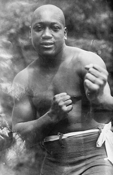 "GALVESTON GIANT- A photograph of former world heavyweight champion, Jack Johnson. ""Lil Artha"" ruled as champion for seven years until 1915; after winning the world title from Tommy Burns in Australia, Boxing Day 1908. #boxing #history"