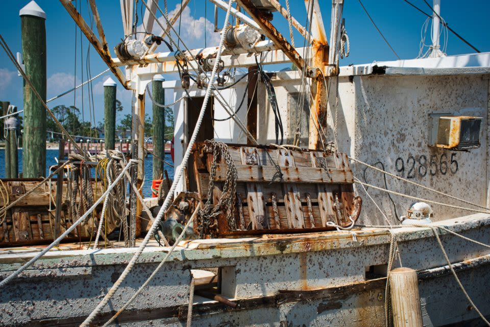 Closeup shot of a fishing boat. It has rust on its outer shell.