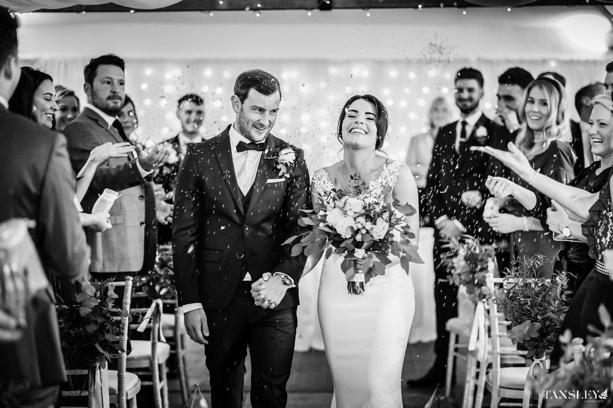 Alex & Tom leaving their wedding ceremony through a barrage of confetti - love that smile on Alex's face. January Wedding at Farbridge, West Sussex.   #reportageweddingphotography  #weddingideas #weddingplanning #weddinginspo #wedding #weddingphotos #farbridge #farbridgeweddingpic.twitter.com/xnbLF0pnqv