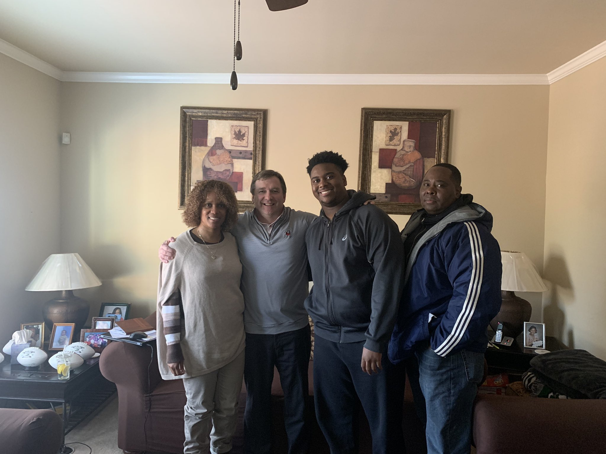 Photo: Cameron Kinney and his family enjoys an in-home visit from UGA head coach Kirby Smart, Twitter