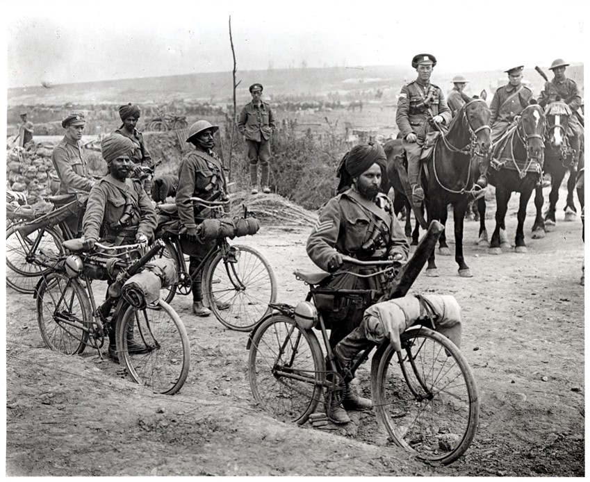 Indian cyclists at a crossroads on the Fricourt-Mametz Road