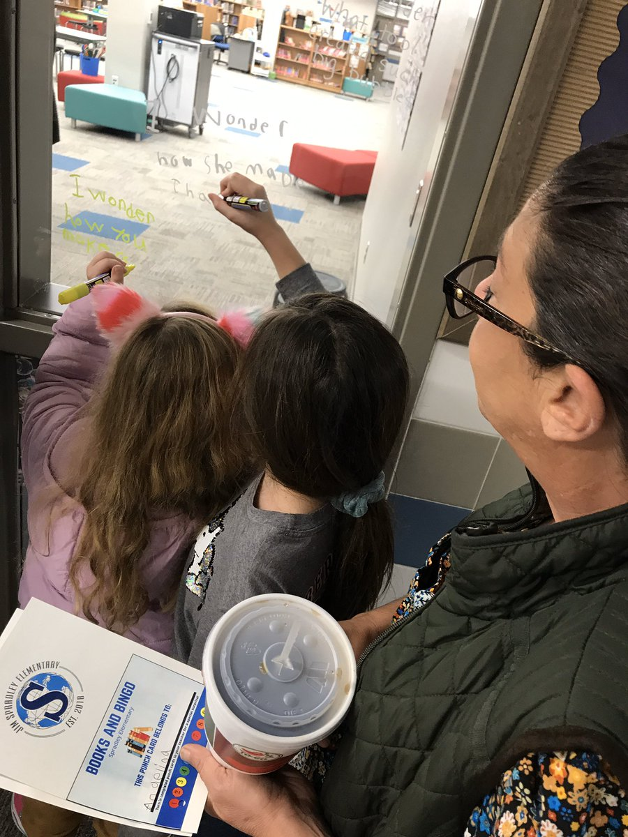 """Families are """"wondering"""" on our window wonder wall at Family Literacy Night! @Spradley_El #PISDLibrary"""