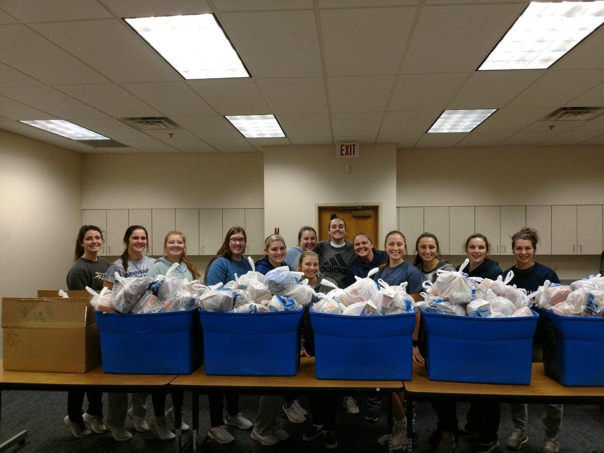 The team helping Abingdon Rotary Club pack bags of food for students at local schools.