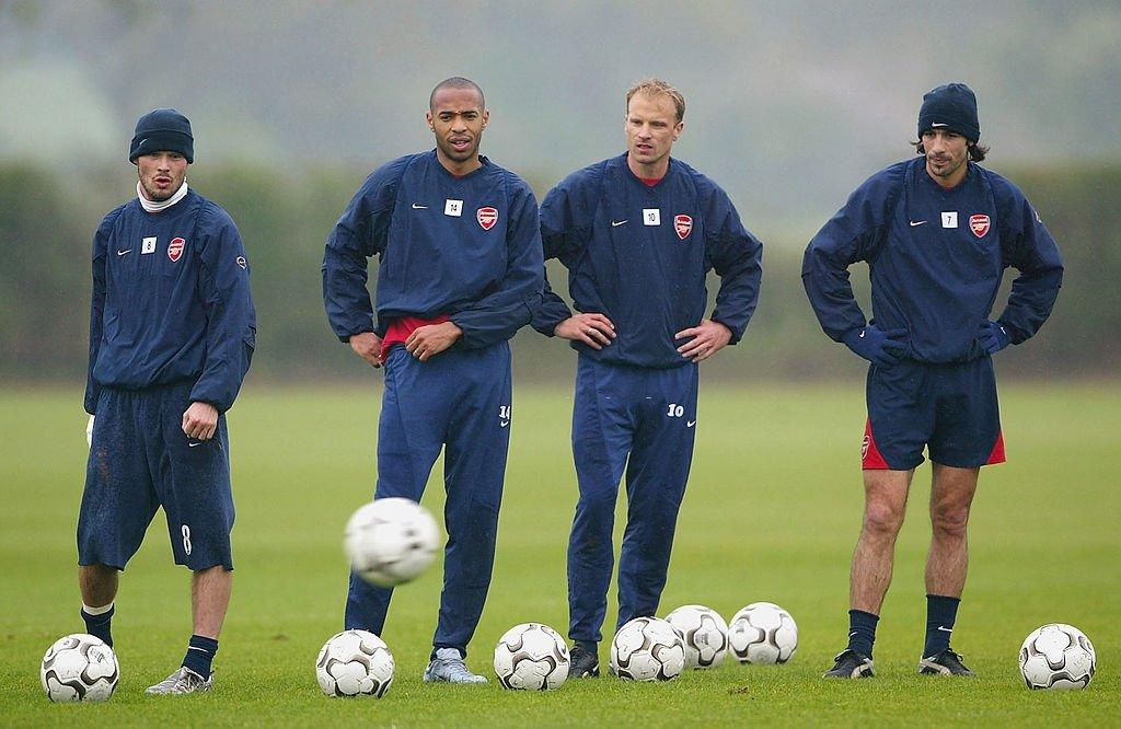 Freddie Ljungberg, Thierry Henry, Dennis Bergkamp, and Robert Pires line up to practise free kicks in training. [Paul Gilham, 2004]