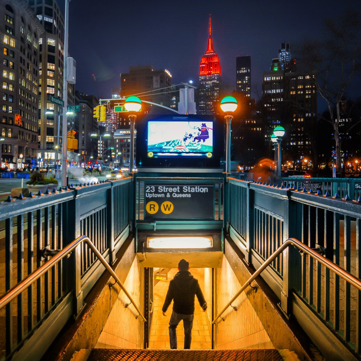 The Empire State Building glowing in celebration of the Lunar New Year, year of the (subway) Rat. Photographed last night at the 23rd Street Station in the Flatiron District.