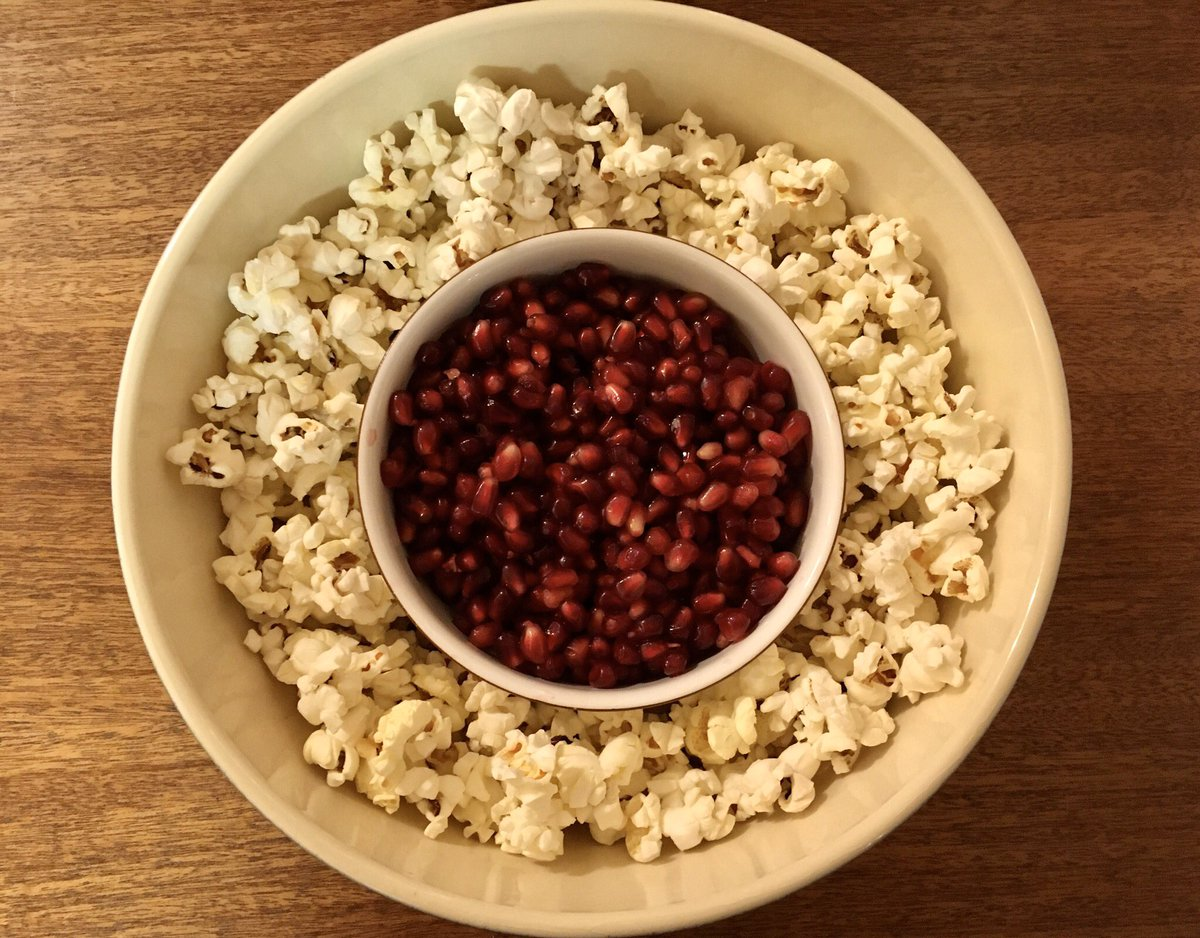 Popcorn and pomegranate seeds: the perfect snack.