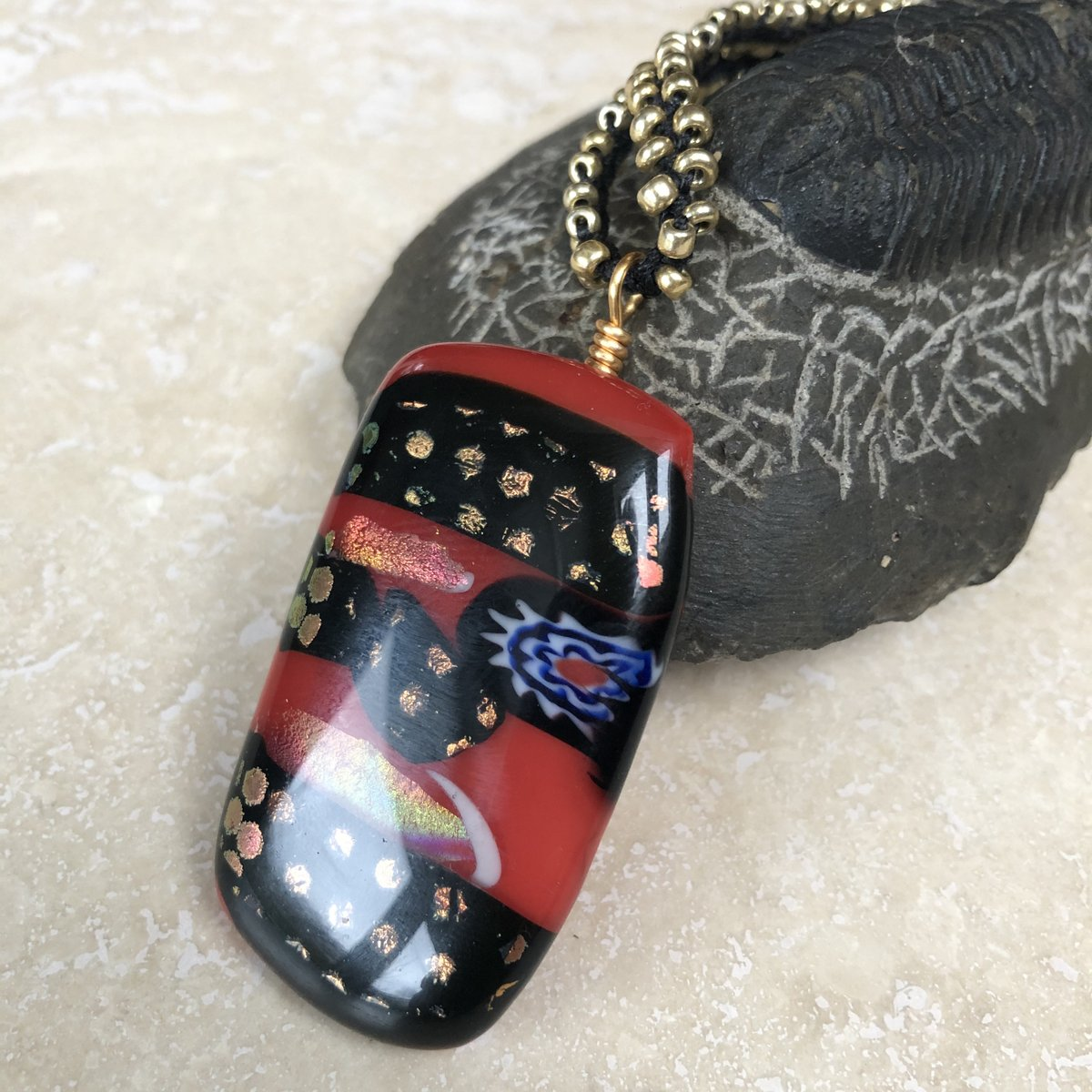 Excited to share the latest addition to my #etsy shop: Fused Dichroic Glass and Micro Macrame Pendant  #jewelry #necklace #red #black #unisexadults #glass #goldplateclasp #goldplatedchain #goldglassseedbeads