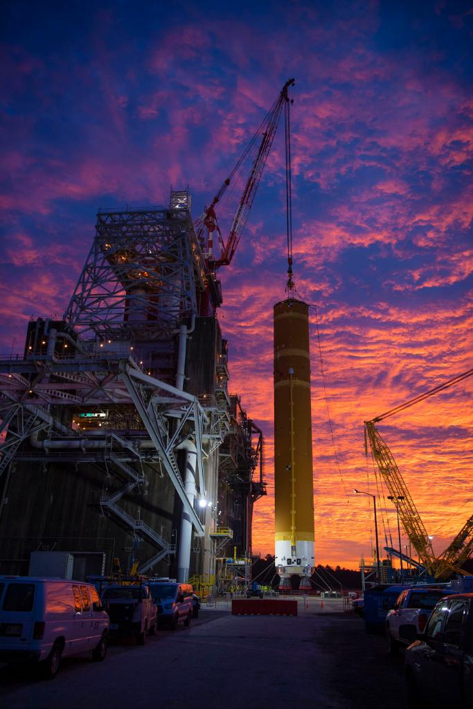 We love when the colors of a sunrise match a rocket stage, dont you? 🌅 More highlights from the installation of the #NASASLS core stage into the B-2 Test Stand HERE >> go.nasa.gov/3avE7C6