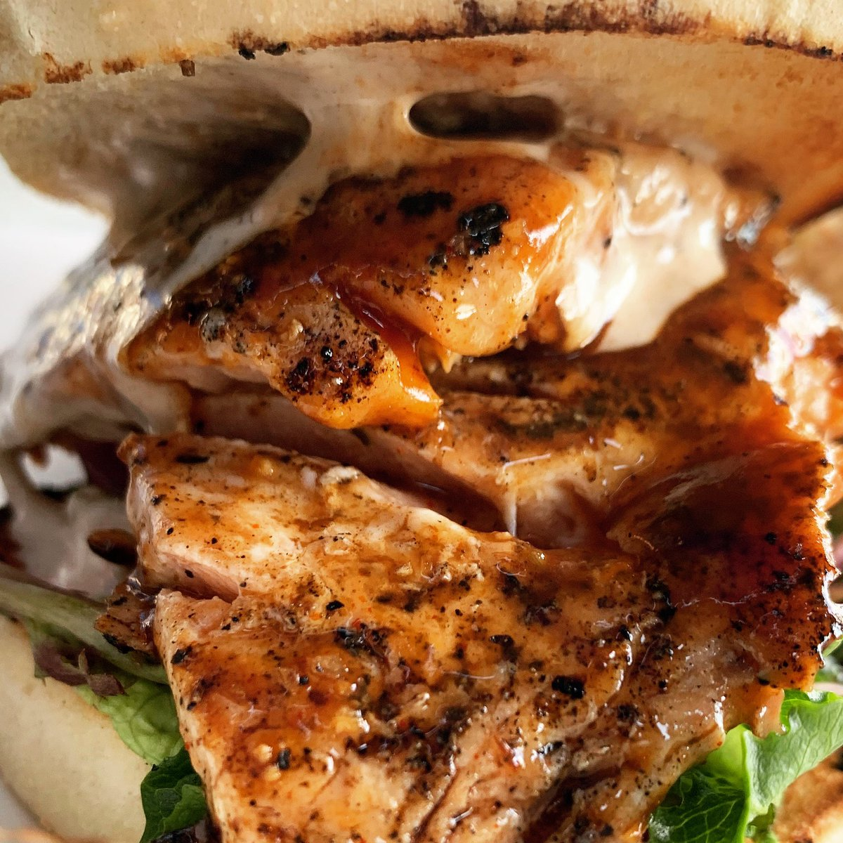Grilled wild pink salmon with citrus infused molasses bbq sauce, marinated red onions and cumin-coriander aioli. pic.twitter.com/13YlwVInxM