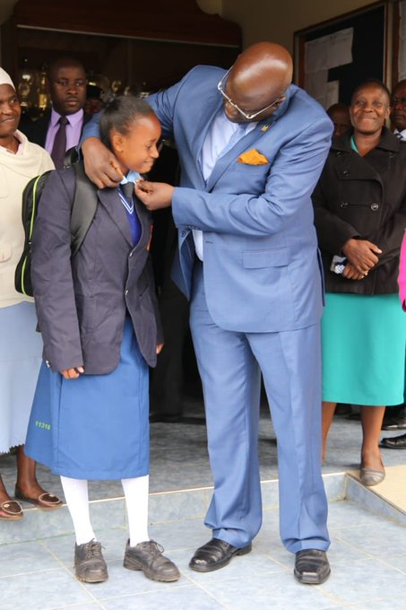 This is how to do it. CS George Magoha helps this young girls to dress up as he led the Form One admission mop up exercise in Nairobi that saw more than 15 students admitted to various schools. The CS said 92pc of last year's one million students have been admitted in the spririt of 100pc transition.