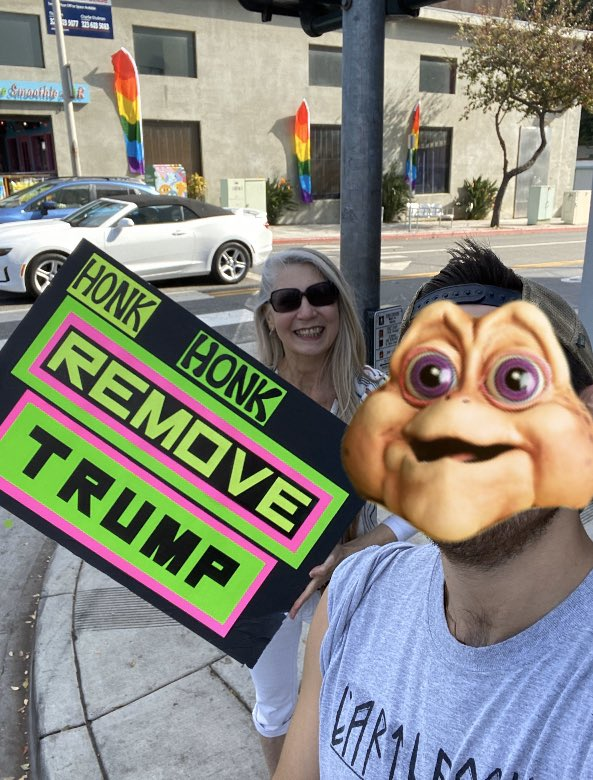 "most literally ran into this woman (I look like the baby from Dinosaurs) outside West Hollywood city hall. She yells ""WooHoo!"" every honk. I never got her name just a selfie because I'm 24 and don't know how to do things that aren't related to my phone!"