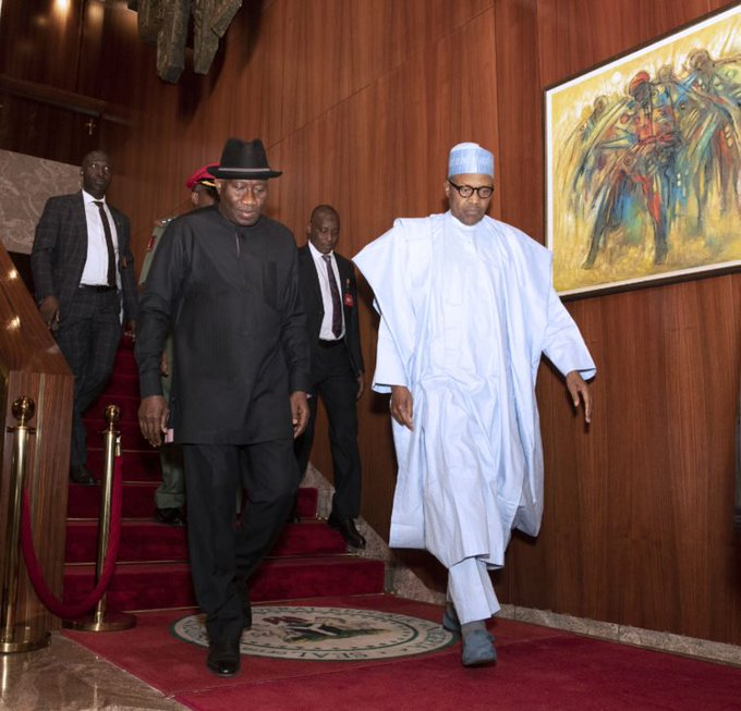 President Muhammadu Buhari while receiving ex-president Goodluck Jonathan