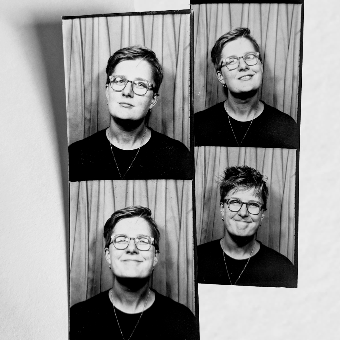 black and white photos of Edi smiling alone, taken in a photobooth