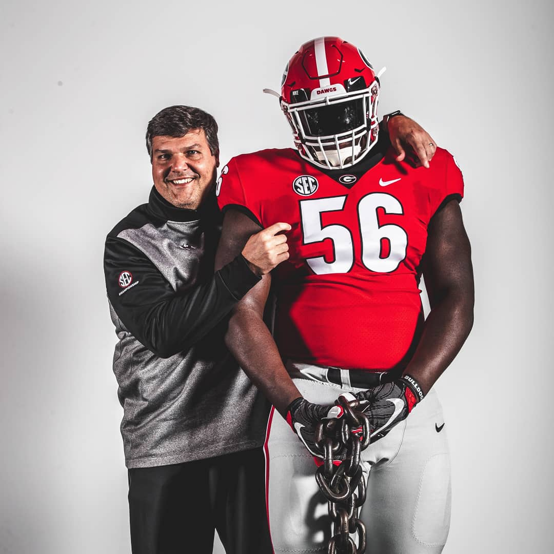 Photo: Georgia offensive line coach Matt Luke (left) with Micah Morris (Right) on an unofficial visit to UGA | Photo from Micah Morris' Twitter