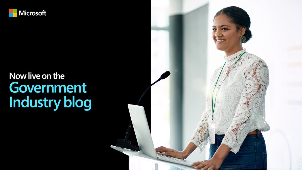 Female industry professional gives presentation at podium with laptop.