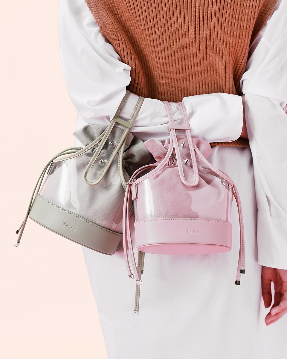 Not just another. The in-demand shape has taken a new turn with a hint of transparency and take on soft shades. The bucket bag. View all the colours here http://bit.ly/3aUVIng  #pedroshoes_official