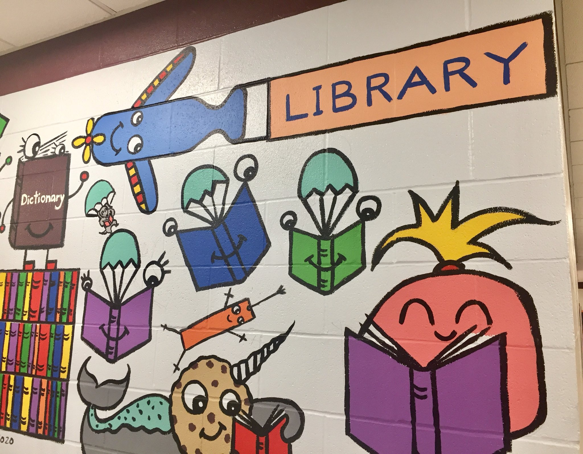 Another detail shot of the Jefferson Elementary mural.... books parachuting from an airplane