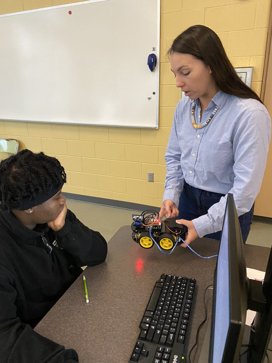Wakefield's <a target='_blank' href='http://twitter.com/GirlsWhoCode'>@GirlsWhoCode</a> working on their Smart Robots. Julia, <a target='_blank' href='http://twitter.com/CodeHS'>@CodeHS</a>, helping them learn how to <a target='_blank' href='http://search.twitter.com/search?q=code'><a target='_blank' href='https://twitter.com/hashtag/code?src=hash'>#code</a></a>! <a target='_blank' href='http://twitter.com/principalWHS'>@principalWHS</a> <a target='_blank' href='http://twitter.com/APSVirginia'>@APSVirginia</a> <a target='_blank' href='http://twitter.com/APS_OEE'>@APS_OEE</a> <a target='_blank' href='http://twitter.com/APSGifted'>@APSGifted</a> <a target='_blank' href='http://twitter.com/wakefieldptsa'>@wakefieldptsa</a> <a target='_blank' href='http://twitter.com/JohnsonCintia'>@JohnsonCintia</a> <a target='_blank' href='http://twitter.com/APSVaSchoolBd'>@APSVaSchoolBd</a> <a target='_blank' href='https://t.co/VLEqypQHcd'>https://t.co/VLEqypQHcd</a>