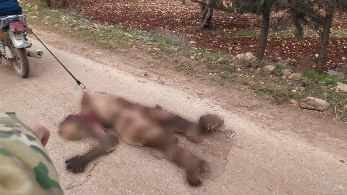 The bodies of the Syrian soldiers killed after Turkey has shooted down a Syrian helicopter in Nayrab, #Idlib. The terrorists backed by #Ankara have tied the bodies to motorcycles and they have dragged them on the ground <br>http://pic.twitter.com/Zl445RRl7c