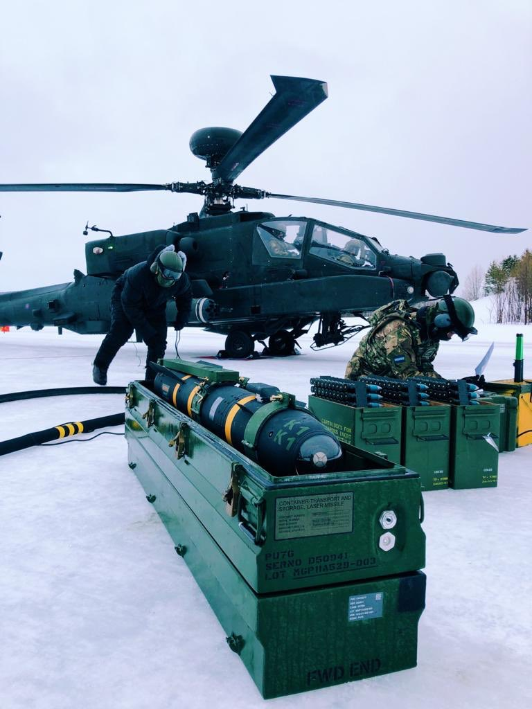 An @ArmyAirCorps #AH64 #Apache arming team getting ready for the first ever Hellfire firing in the Arctic. Challenging work led by AAC JNCOs executed by Airtroopers from @4RegimentAAC. #ArmyConfidence @ComdJHC @aacrecruiting https://t.co/5a26raWkXh