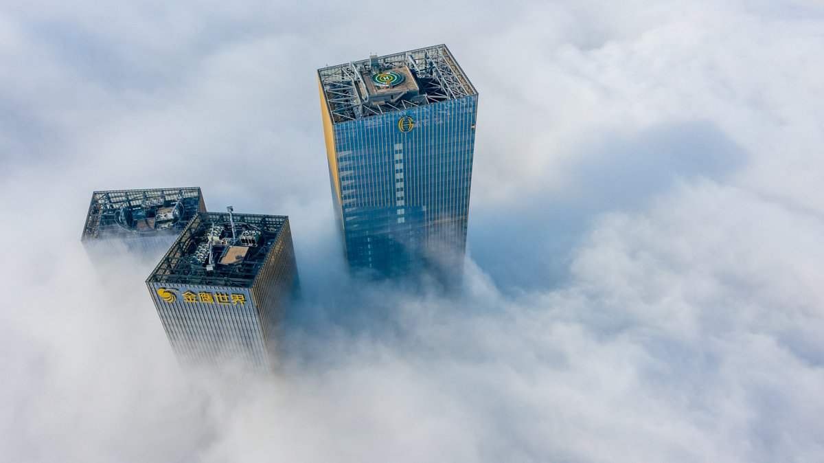 Up in the clouds: Mist shrouds skyscrapers in Nanjing,  east China