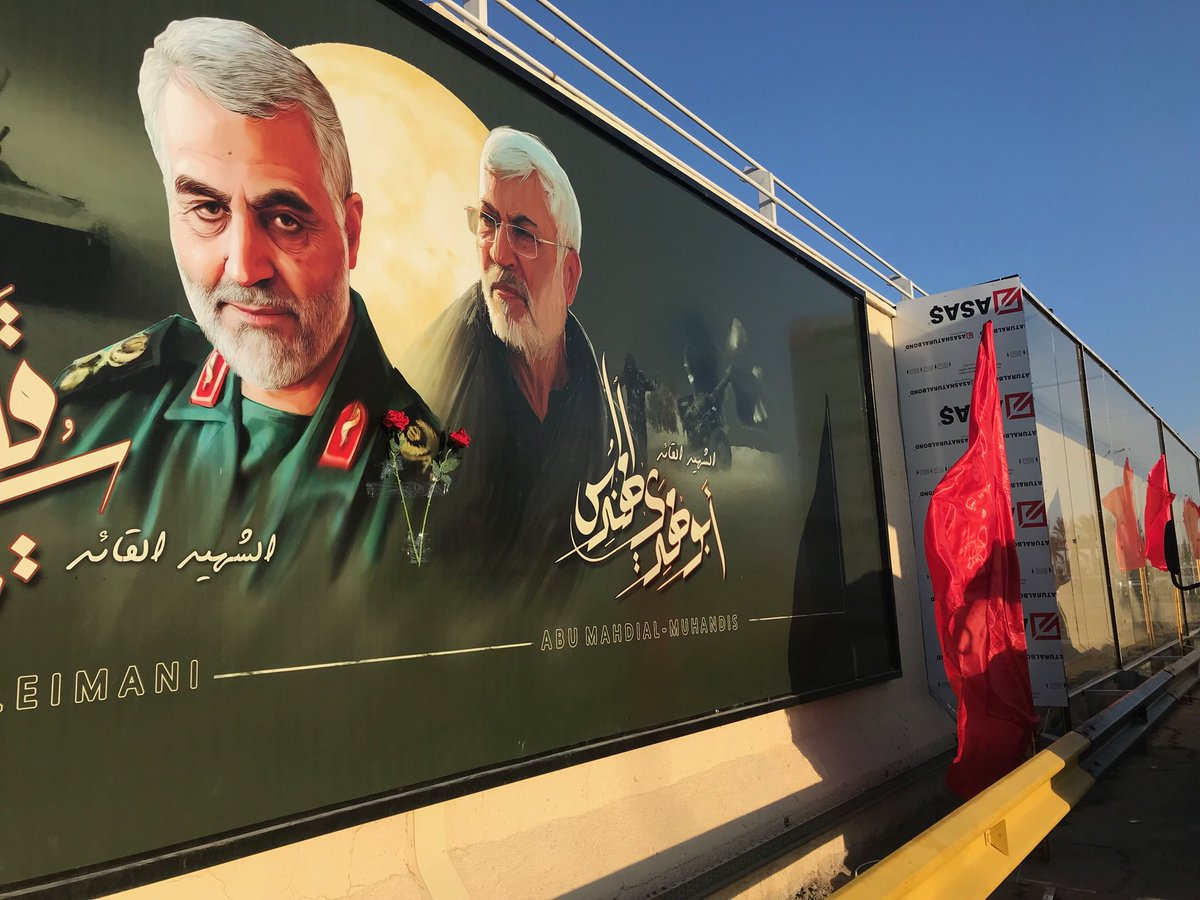 Commemoration on #Baghdad airport road on 40th day after US drone strike killed #Iran's general Soleimani and #Iraqi militia leader al-Mohandis. Posters put up and shrapnel  holes preserved behind plexiglass. Women chanted 'death to America'.