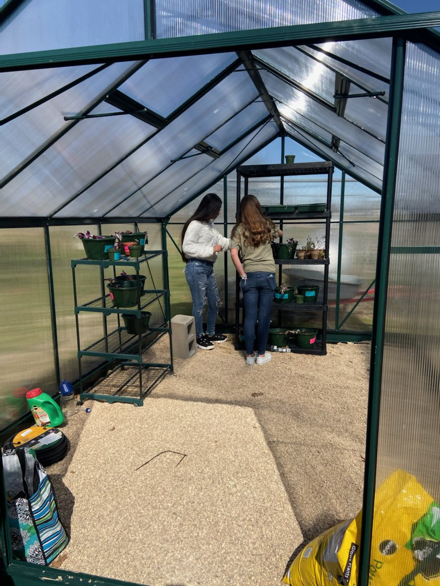Students enjoying working in their new greenhouse! #ourWHY @chinaspringisd