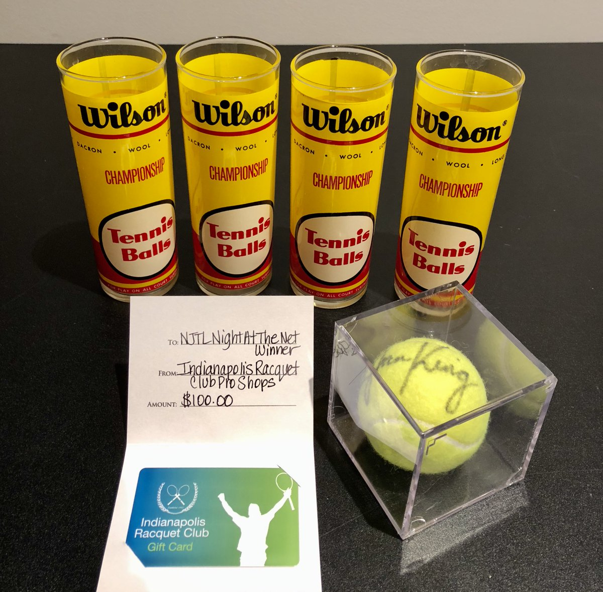We're just NINE days from NIGHT AT THE NET!  Check out one of our silent auction packages for #ThrowbackThursday. Glasses that look like vintage Wilson cans!  The winning bidder also gets an @IRCTennis gift card and a Billie Jean King signed ball!  🎟️:  https://www.eventbrite.com/e/night-at-the-net-presented-by-njtl-of-indianapolis-tickets-88745517231…