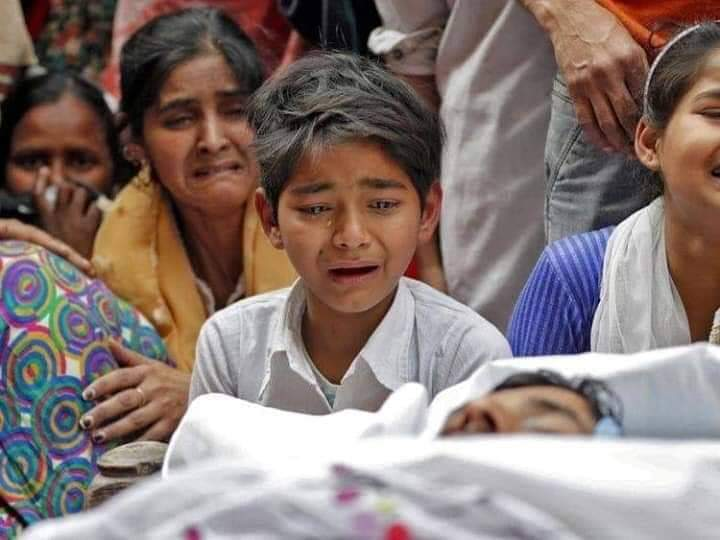 Son of Muddasir Khan, the Martyr of Delhi Genocide with tears in his eyes.   A son lost his father.. A wife lost her husband, A mother lost her son..If this doesn't make you sad, nothing will..  Pic courtesy: Sahil Kazmi  #DelhiRiotTruth <br>http://pic.twitter.com/311yLVVdb3#DelhiRiotTruth<br>http://pic.twitter.com/z81SmuecPV