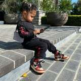 Stormi Looks Cooler Than Most Adults in These Red Nikes and Her Rhinestone-Encrusted Purse pic.twitter.com/ulPK3P6ND9