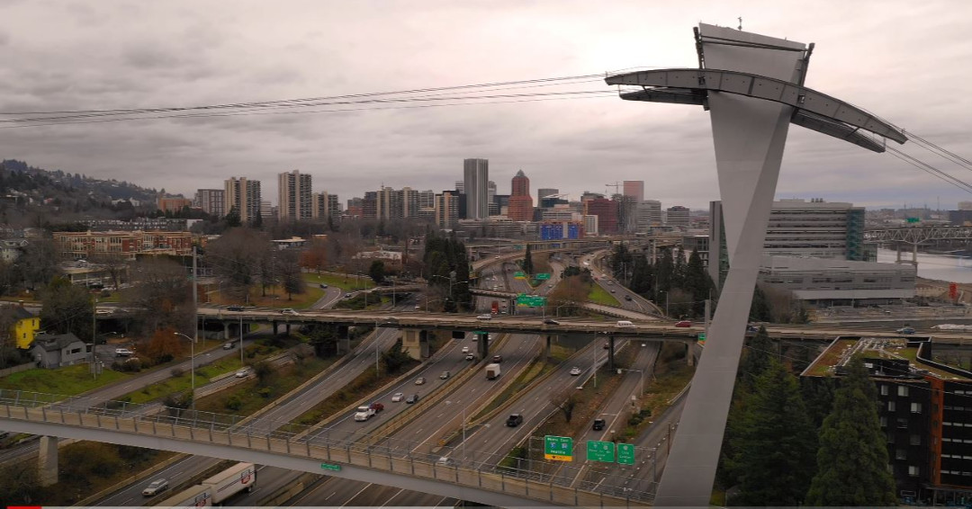 Portland Tram Cable Cars Glide over Interstate 5 Oregon State Video Clip    #nature #photo #travel #art #picoftheday #aerial  #mountain #oregon #footage #tram