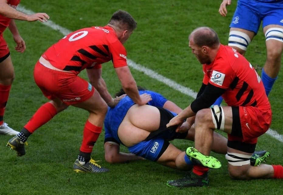 Rugby ball up the arse