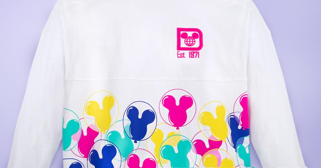 A white Spirit Jersey with colorful Mickey balloons