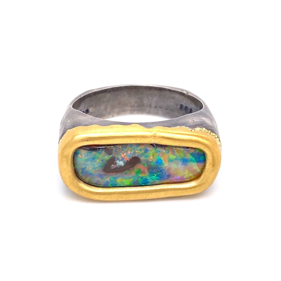 Opals aren't just for the ladies! Check out this gorgeous new men's #opal #ring!  #llynstrong #llynstrongfinejewelry #strongpersonality #jeweler #localartist #jewelryartist #designer #artjewelry #modullyn #oneofakind #gemstones #gifted #precisionjewelry