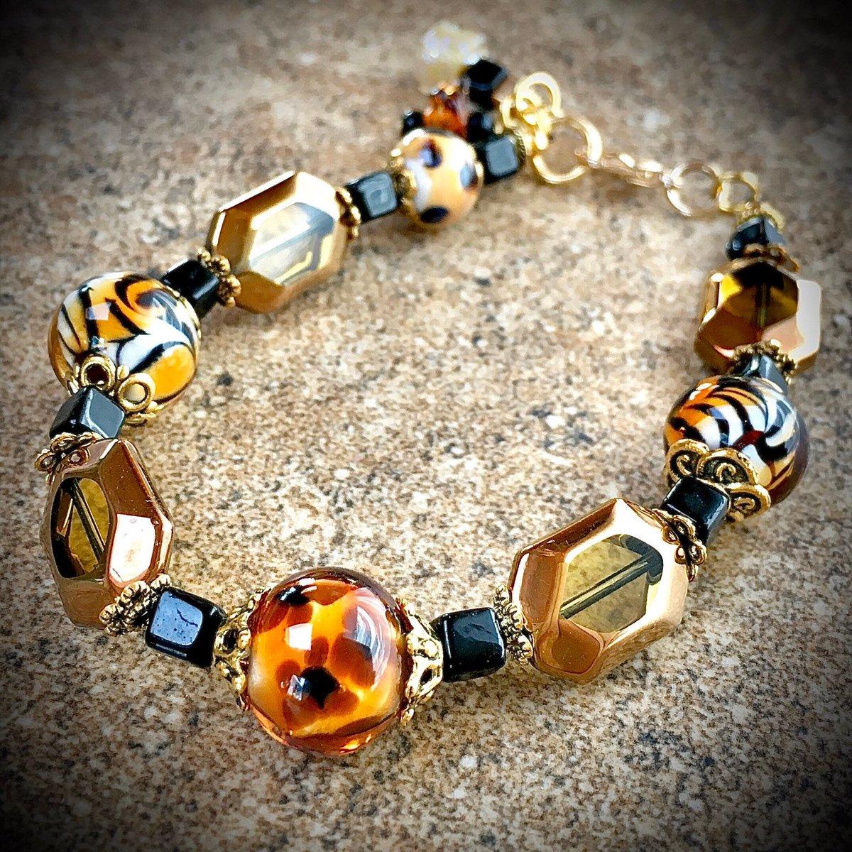 Look what I made! Animal Print Lampwork Bracelet #jewelry #bracelet #lampwork #handmade #lampworkbead #animalprint