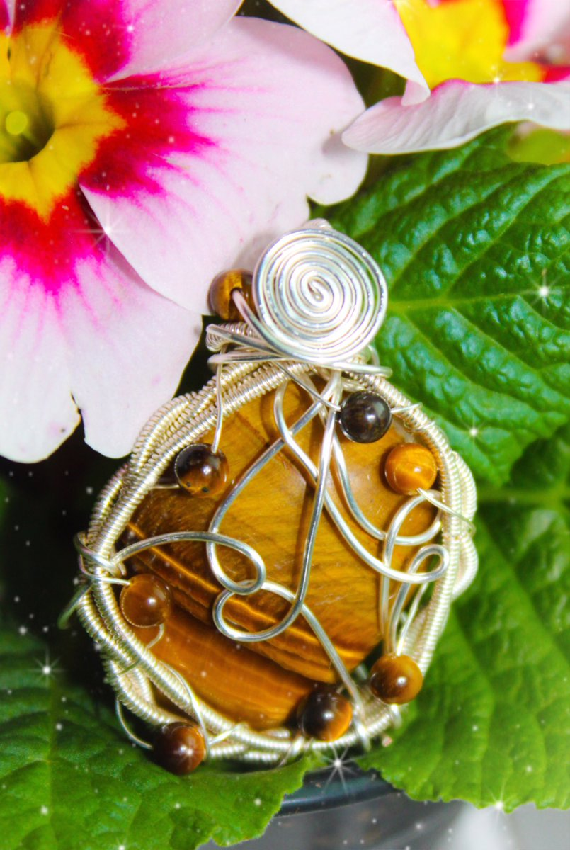 this beautiful tigers eye pendant is still available on my website! comes on an adjustable necklace cord. tigers eye is great for grounding, protecting your energy, and increasing your psychic skills + spirituality ✨