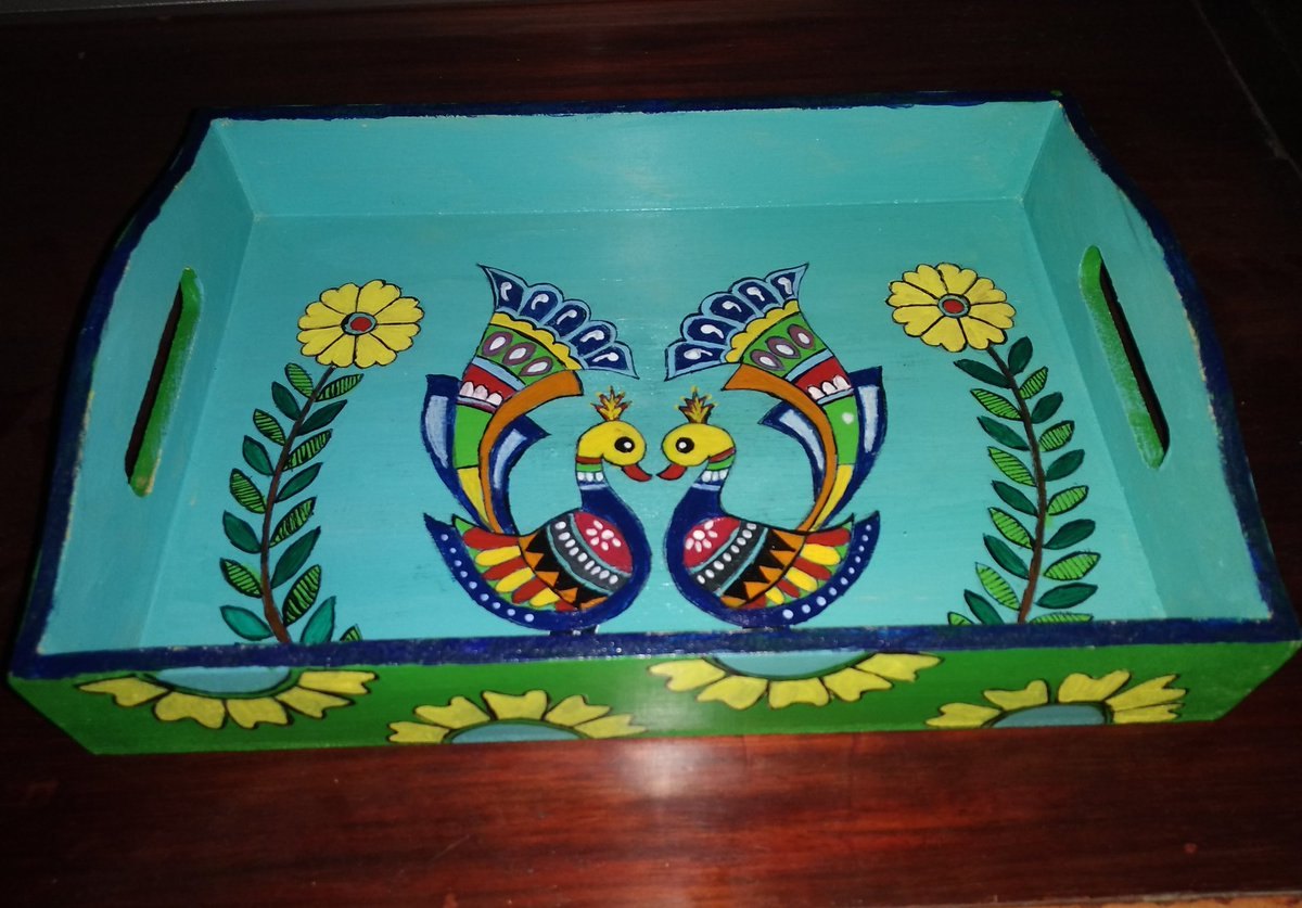 I seem obsessed with peacock designs. Might have tried atleast 4-5 peacock designs on different bases. I had done this one on a MDF tray using acrylic colours , some time back. #myart #hobbies #handpainted pic.twitter.com/f4D4CKNBL4