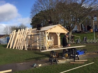 The new Clubhouse going up quickly.  Many thanks to the PTA for making it all happen.  Let's hope the rain keeps off until the roof is on....