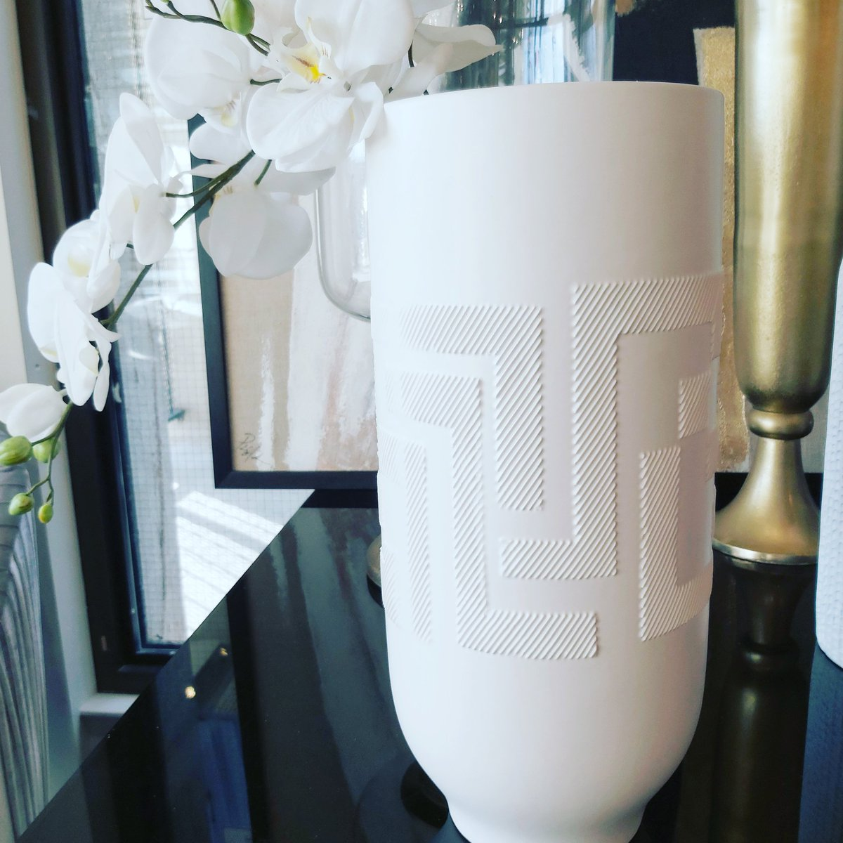 If you are going all white celebrate the details. #monochromatic #artdeco #details #itsinthedetails #vases #orchid #homestyling #homedecor #interiordesign #whiteaccents