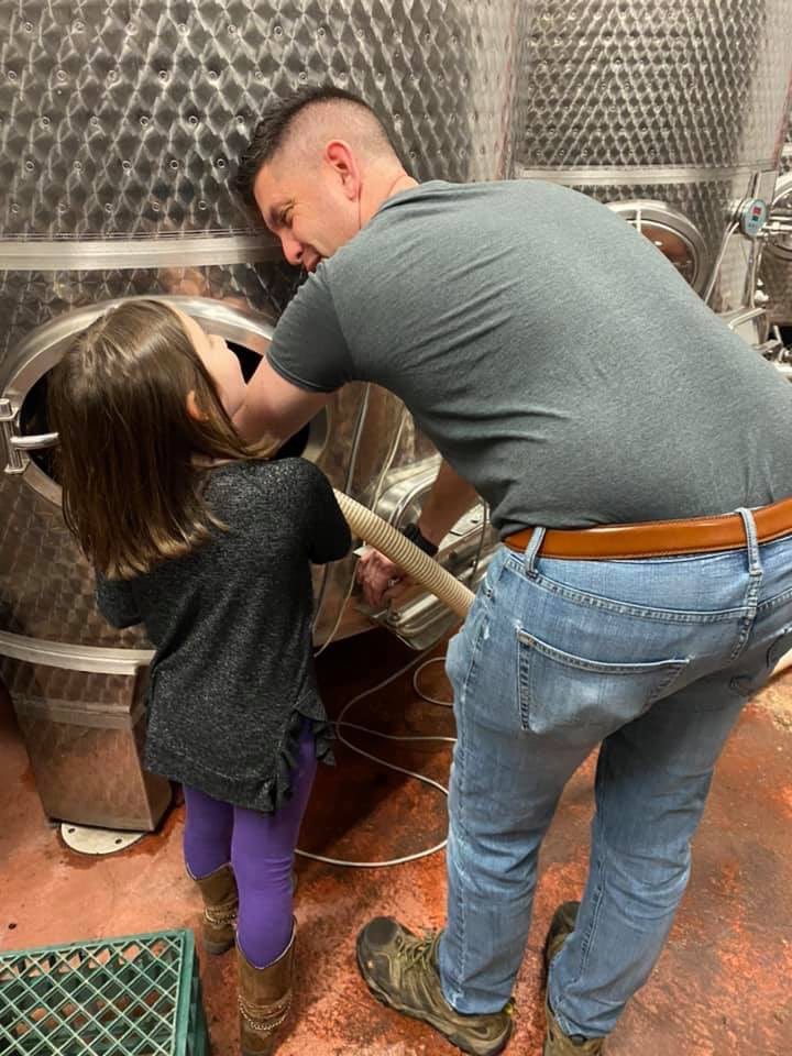 """""""It smells like strawberries dad!""""Madelyn helping Matt rack the 2019 Brut Rose' sparkling base wine. ❤️Happy National Drink Wine Day from your friends at M Cellars"""