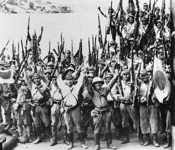 """Japanese troops march in triumph into Singapore, which conquerors have renamed Shonan- """"light of the south"""":"""