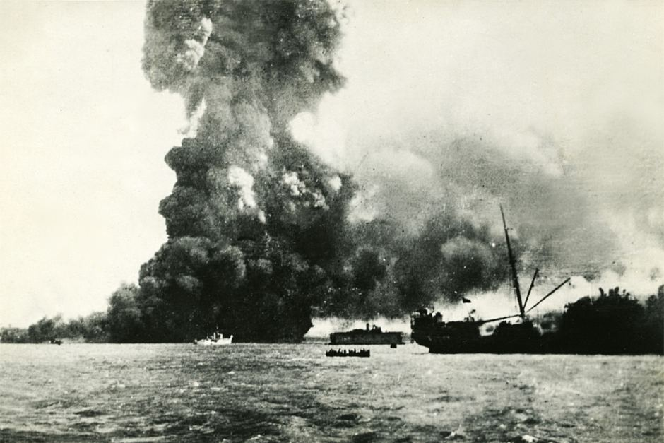 Japanese bombs rain on Dawin Harbour; freighter Neptuna, loaded with TNT, explodes in a vast pillar of flame, killing 36 crew.