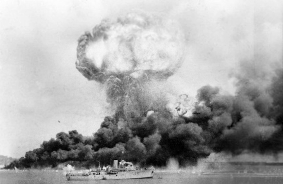 Japanese bombing has left Darwin port & city wrecked- 8 ships sunk, 200+ Australians dead, just 4 attacking planes shot down.
