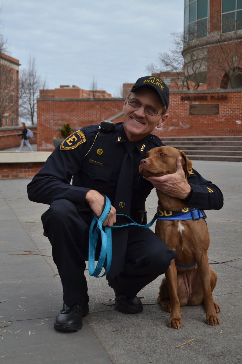 We're so excited to introduce you to Pepper! She is the new therapy dog on campus. She's being cared for by Community Relations Officer Mitchell.   Join us in welcoming Pepper to the #ETSU family! If you see her on campus, stop and say hello. 💙 💛