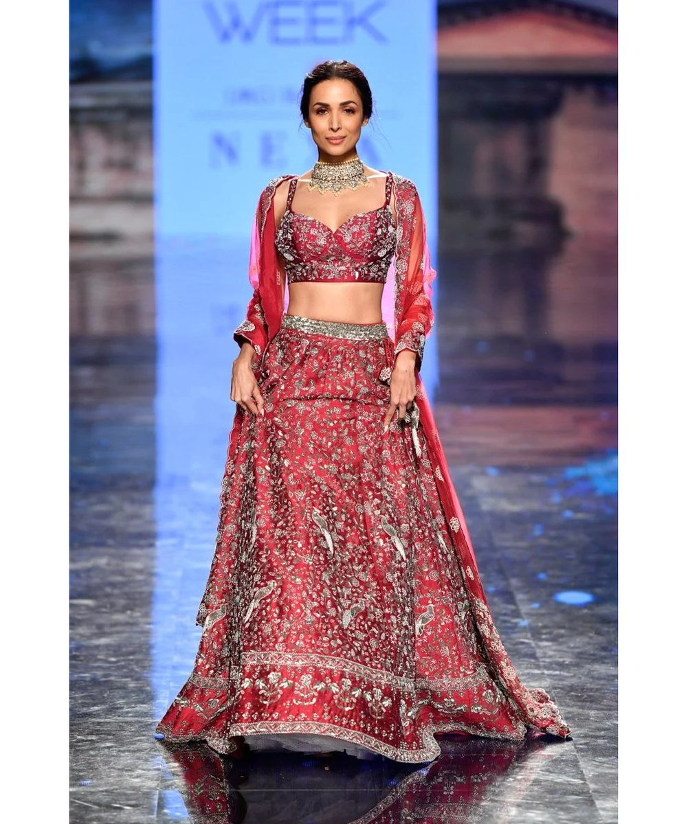 Malaika Arora in a designer bridal wear at one of the Lakme Fashion Week summer / resort 2020 events. (Image Source: http://Vogue.in )  #malaikaarora #bridalwear #bridaldress #designerbridalwear #designerbridaldress #LFW2020 #lakmefashionweek #summerresort2020pic.twitter.com/6VYbhGuXtY