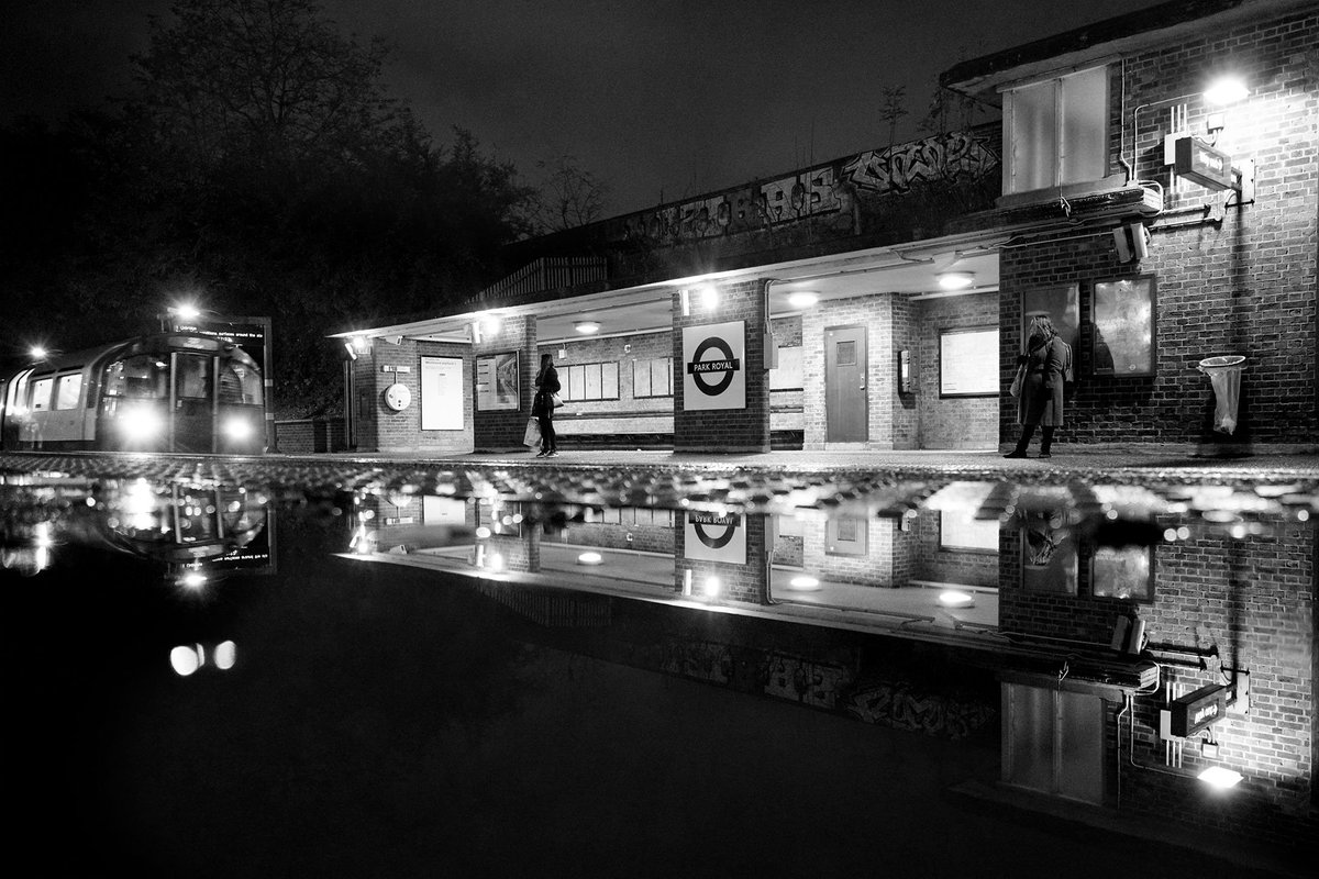 A Night's Reflection - Park Royal   A rainy night shot as a train approaches Park Royal London Underground station.  By Luke Agbaimoni http://instagram.com/tubemapper http://tubemapper.com   #travel #photography #london #blackandwhite #tflpic.twitter.com/SiQypnLpPL – at Park Royal London Underground Station